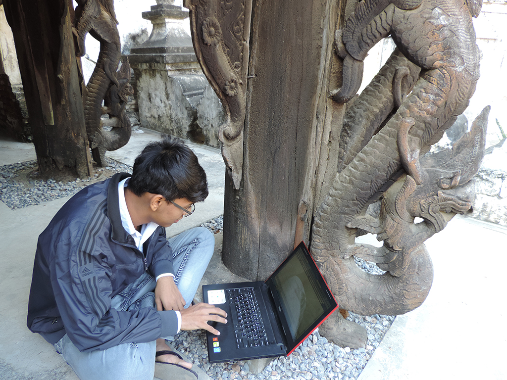 A student checks autocad drawing against the actual nayar at Shwe-nandaw.