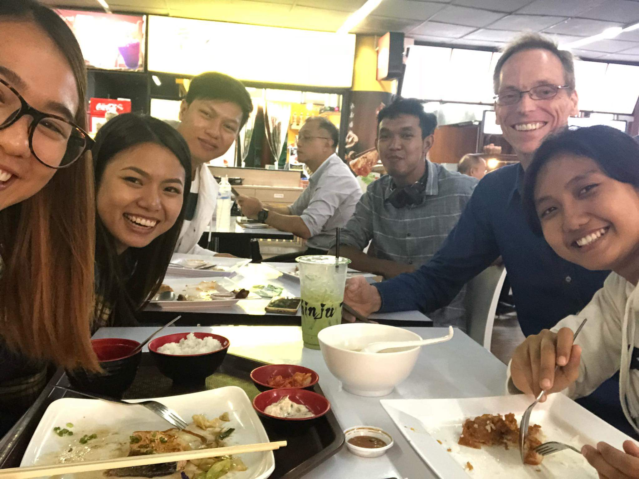 Students and WMF's Jeff Allen dine at Don Mueang Airport in Bangkok.