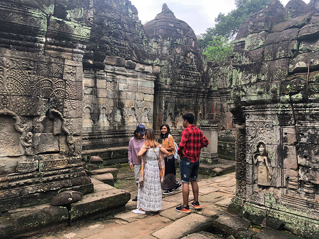 Students visit Angkor ruins with WMF architect Cheam Phally.