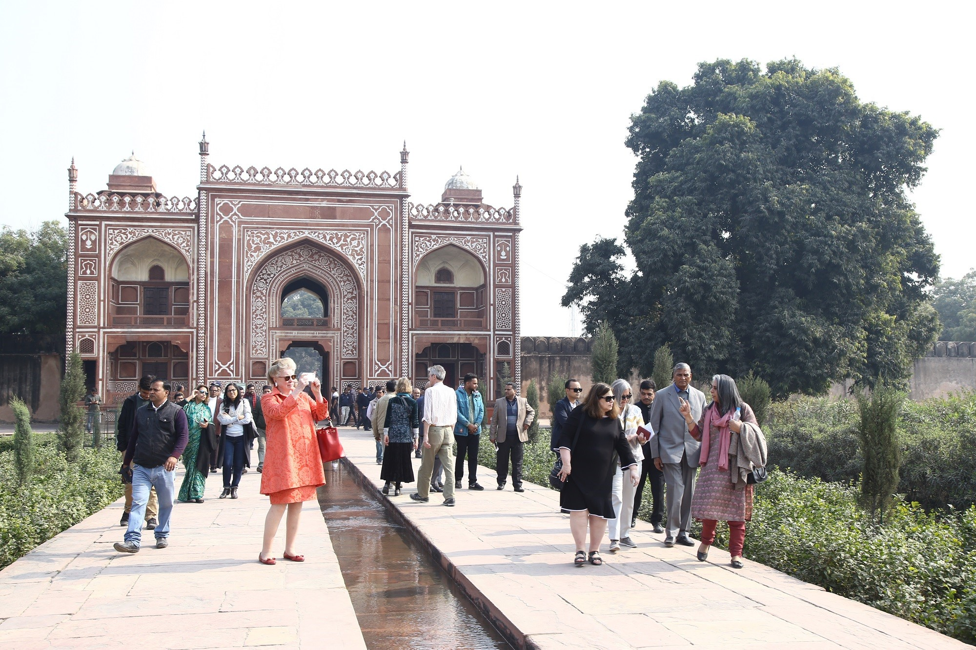 Guests tour completed conservation of the garden of the tomb of I'timad-ud-Daulah.