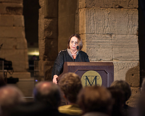 Bonnie Burnham speaks in front of the Temple of Dendur at the Metropolitan Museu