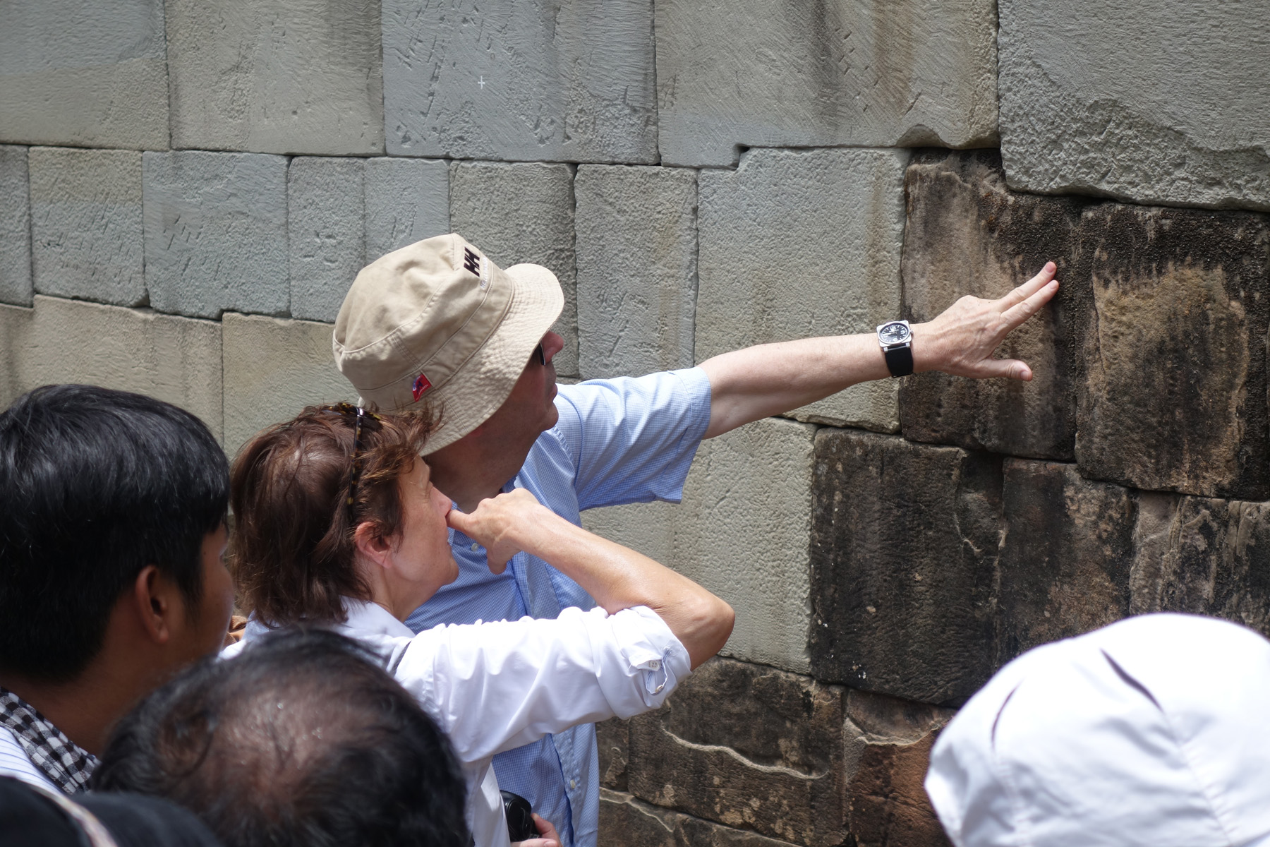 Pierre Andre Lablaude inspects stonework at Angkor's Phnom Bakheng temple, 2014.