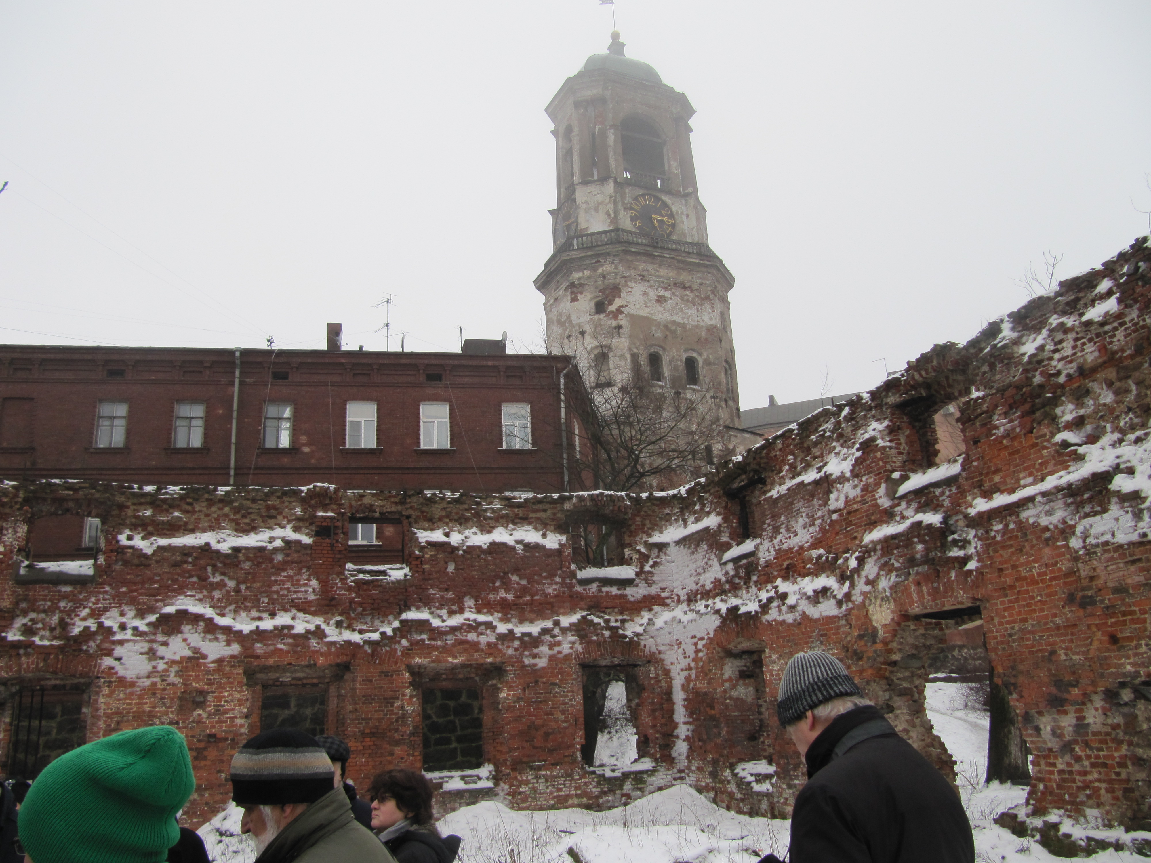 Vyborg's unprotected clock tower appears behind the ruins of the old cathedral, 2016.