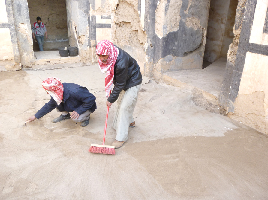 Adding clean earth in courtyard at  Nabu-sha-Khare Temple