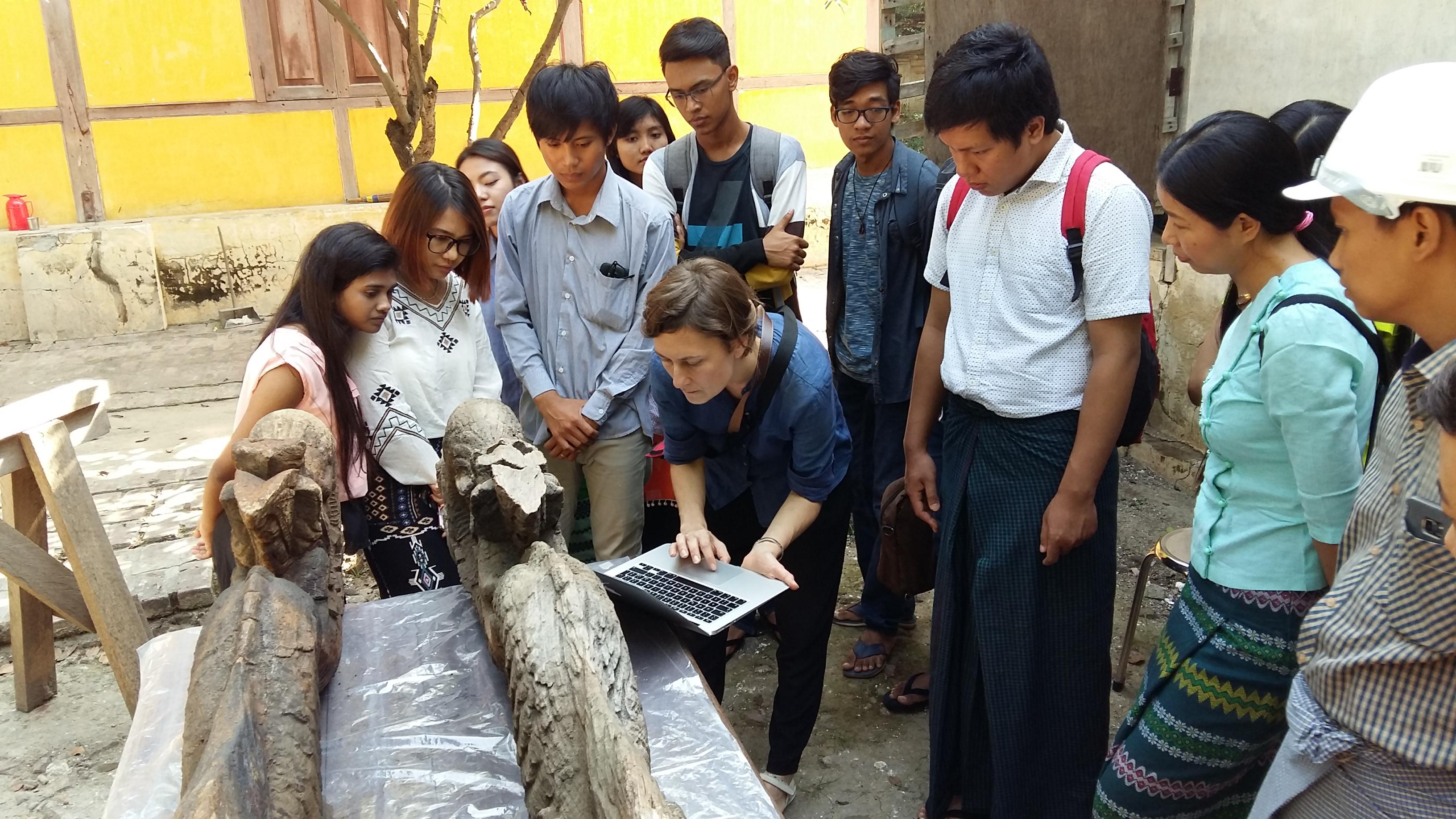 Conservator Urszula Strugala reviews nayar documentation with students.