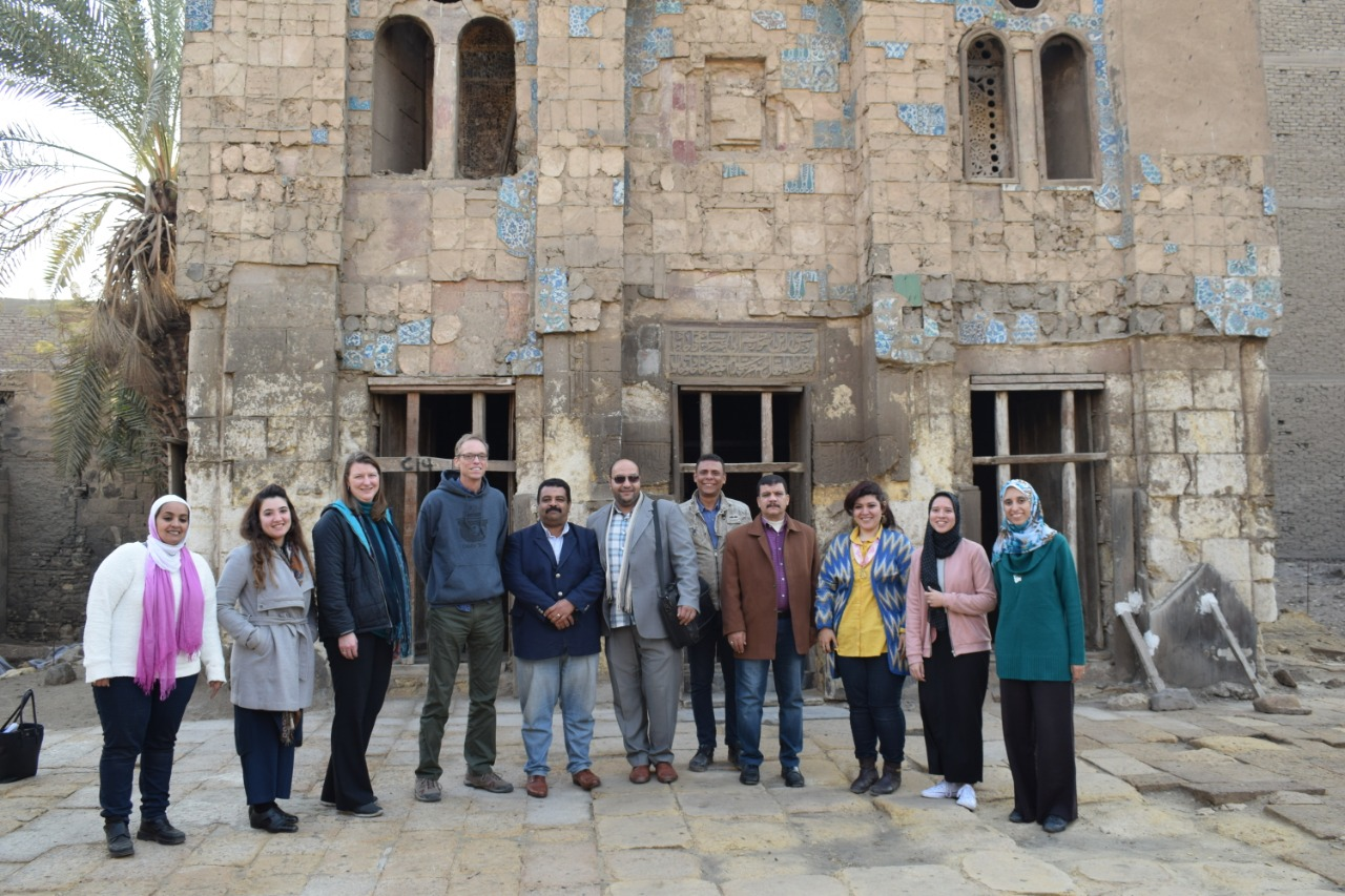 Abeer Saed Eledeen, far left, and Amira Souliman, second from right, with Takiyyat al-Gulshani full-time staff, representatives from the US Embassy in Cairo, and members of the Egyptian Ministry of Tourism and Antiquities.