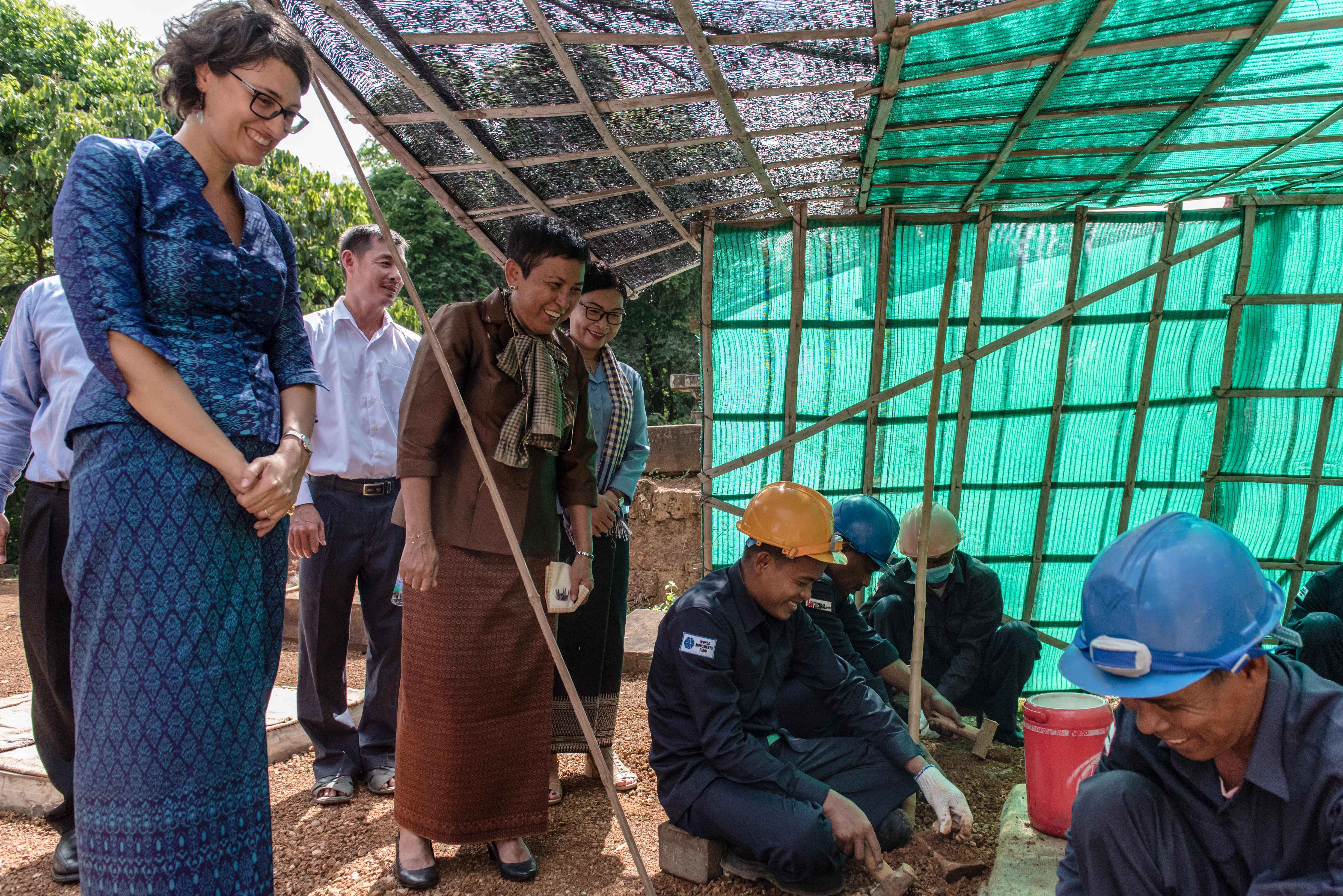 WMF's Ginevra Boatto and Her Excellency Dr. Phoeurng Sackona observe conservation work. Photo by Amine Birdouz.