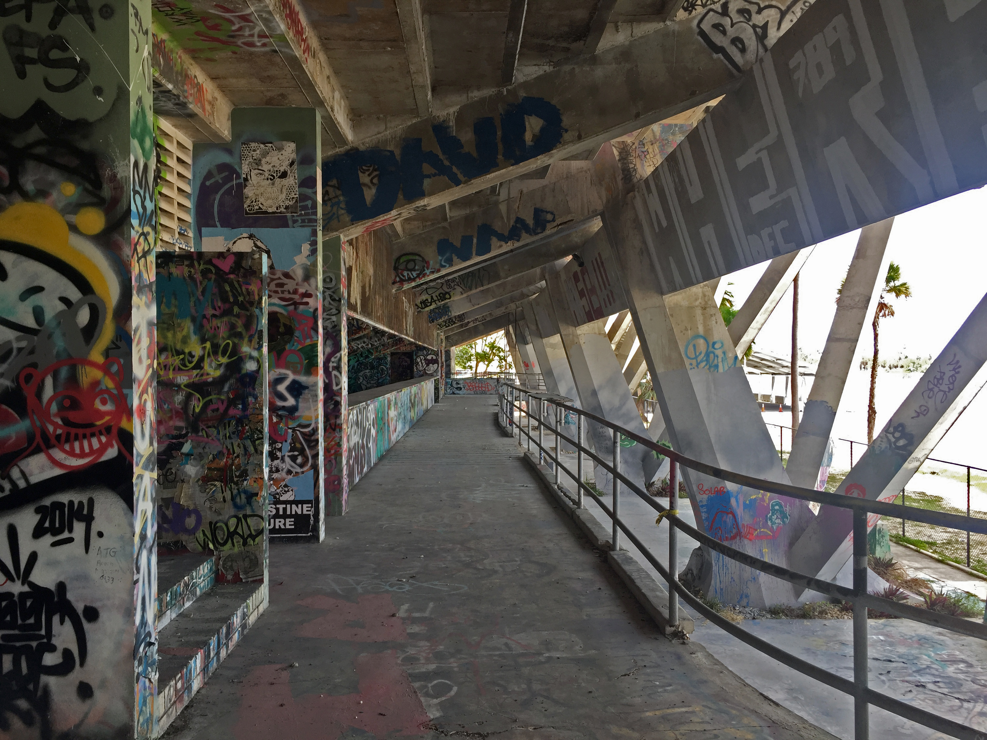 The graffiti-covered walkway underneath the grandstand.
