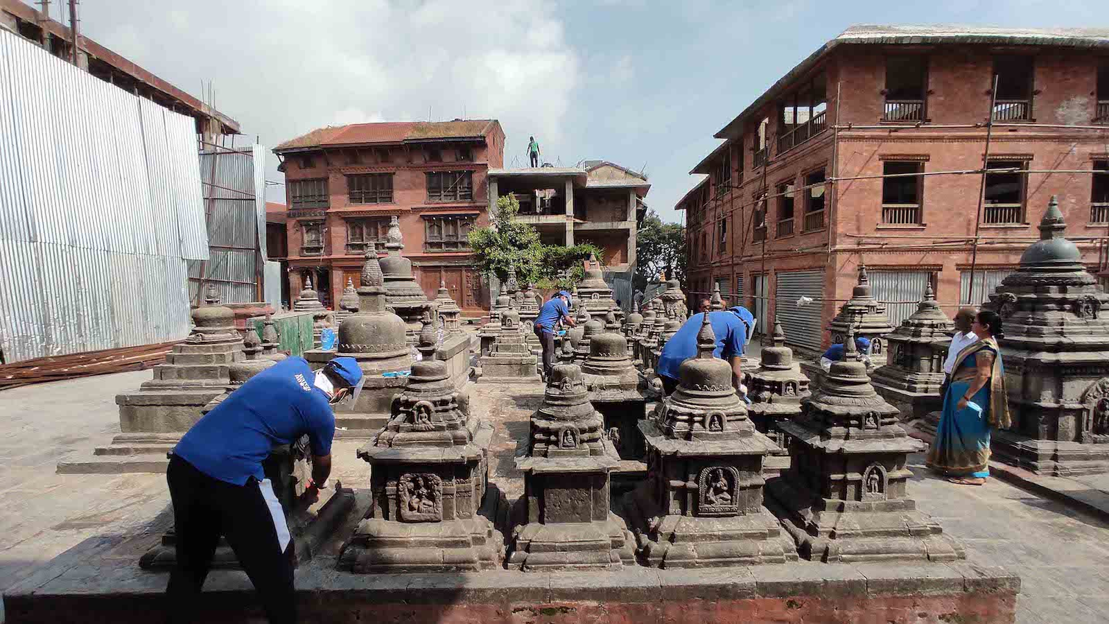 Careful cleaning of the chivas of the Swayambhunath temple, Nepal.