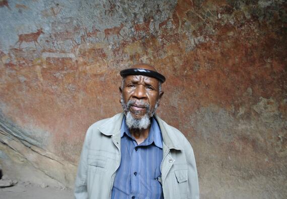 David Ngwenya before the endangered rock art of Matobo Hills.