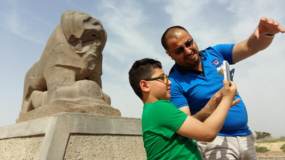 Visitors at the Lion of Babylon in Iraq.