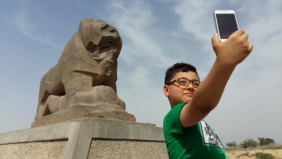 A young visitor at the Lion of Babylon, Iraq, 2016.