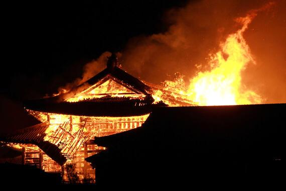 Fire engulfs Shuri Castle.