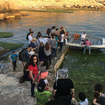 A boat tour in the Dalieh of Raouche during Beirut Watch Day.