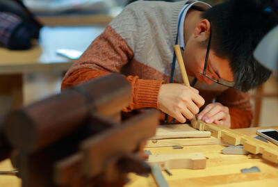 CRAFT student performing hands-on work