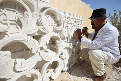 Mohammad Dorzi working on a wall fixture
