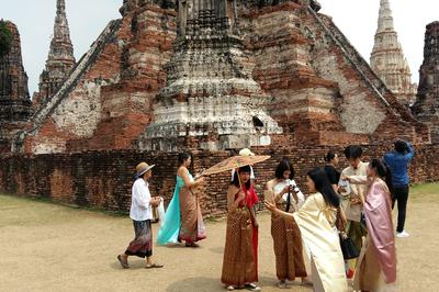 Fans of the show Love Destiny pose for photos in costume at Wat Chaiwatthanaram.