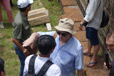 Pierre Andre Lablaude speaks with conservators at Angkor's Phnom Bakheng temple, 2014.