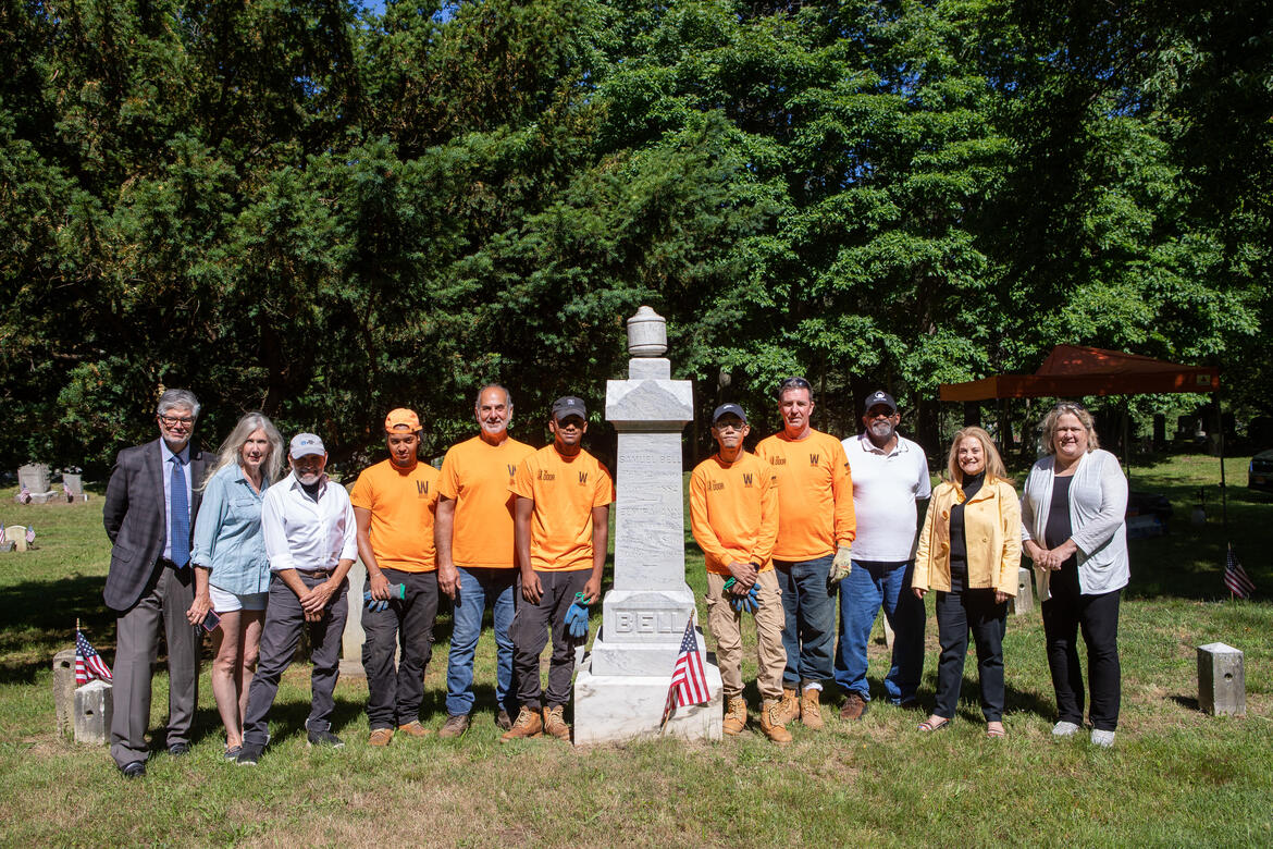 From left to right, standing next to the Bell Family monument: Nicholas Pisano, Vice President & Chief Financial Officer, WCC; Suzanne Clary, President, JHC; Frank Sanchis, WMF; Oliver Moran Sepulveda, Apprentice; Robert Cappiello, Resident Craftsman; Jonathan Mendoza, Apprentice; Kenny Tuy, Apprentice; Gerald Dowd, Assistance Craftsman; Dave Thomas, Founder, FOACC; Debbie Reisner, Town of Rye; Susan Olsen, Director of Historical Services; Maxwell Pisano, Preservation Intern.