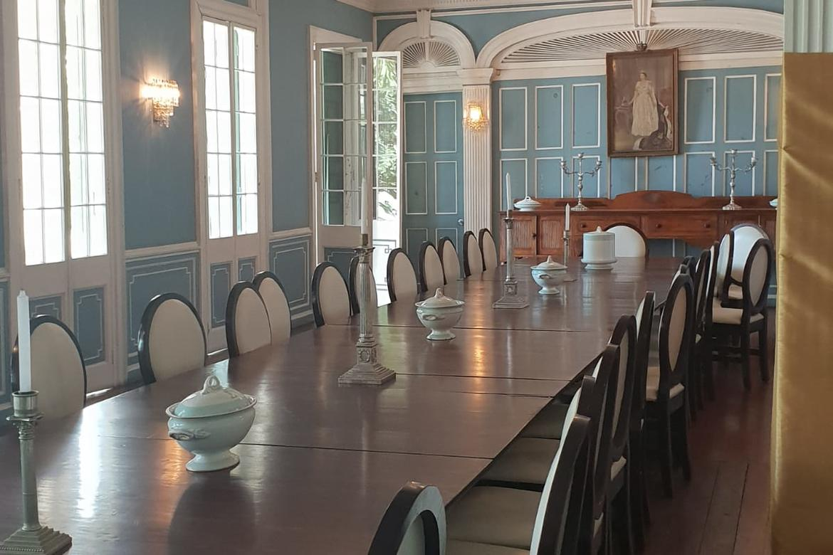The Dining Room of the main building decorated with ceramic and porcelain wares with the Government House's monogram