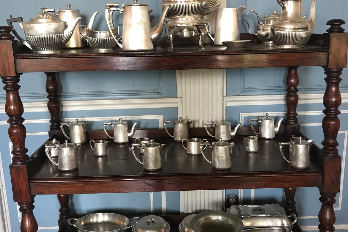 Silverware engraved with Government House's monogram on display in the Dining Room