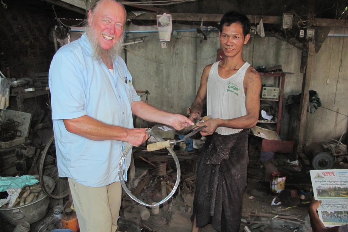 Since the master blacksmith, Than Naing Oo, spoke no English, and I spoke no Myanmar, we worked from photos and drawings. Photo by Laura Saeger.