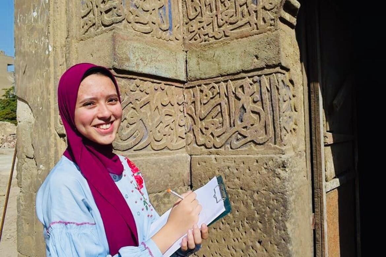 Amira Souliman taking assessment notes of the exterior of Takiyyat Ibrahim al-Gulshani.