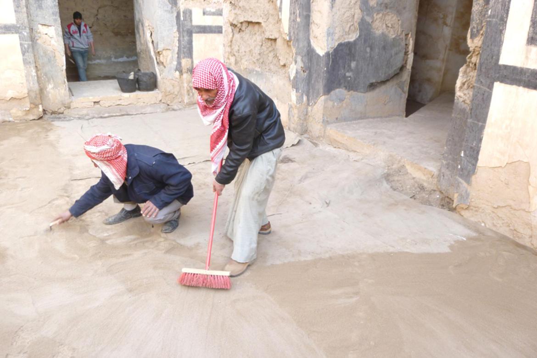 Adding clean earth in courtyard at  Nabu-sha-Khare Temple