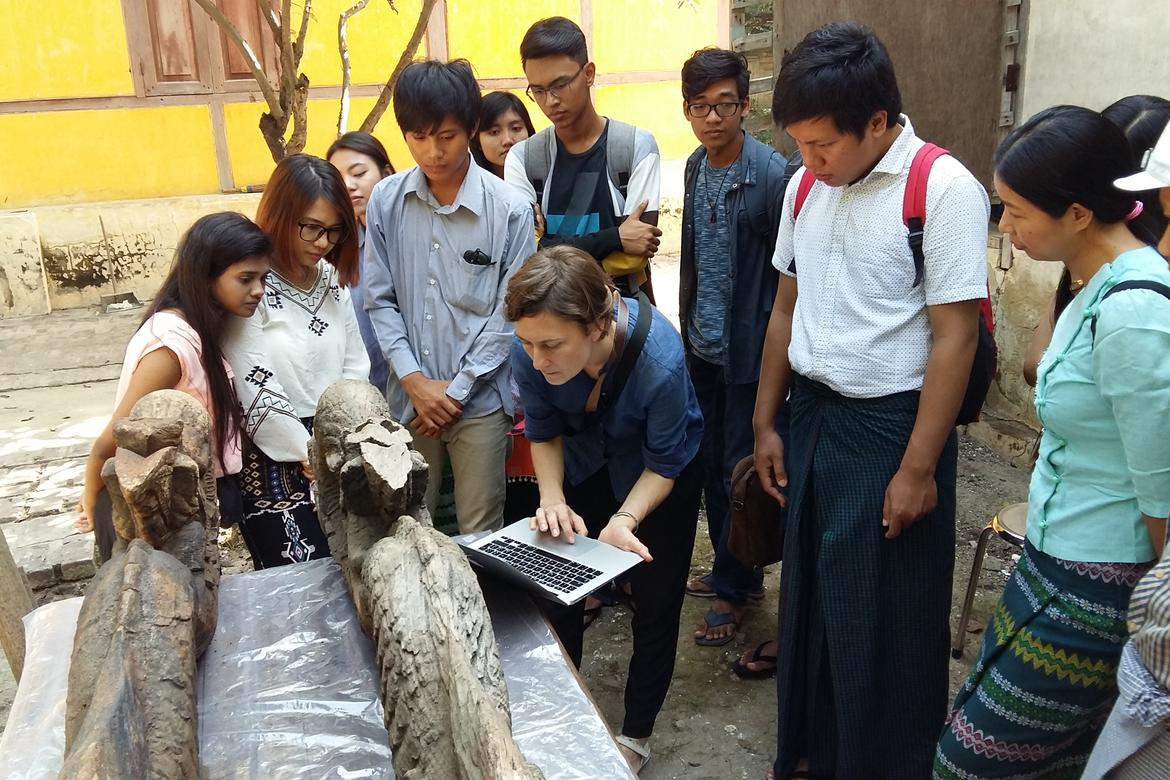 Conservator Urszula Strugala reviews nayar documentation with students.