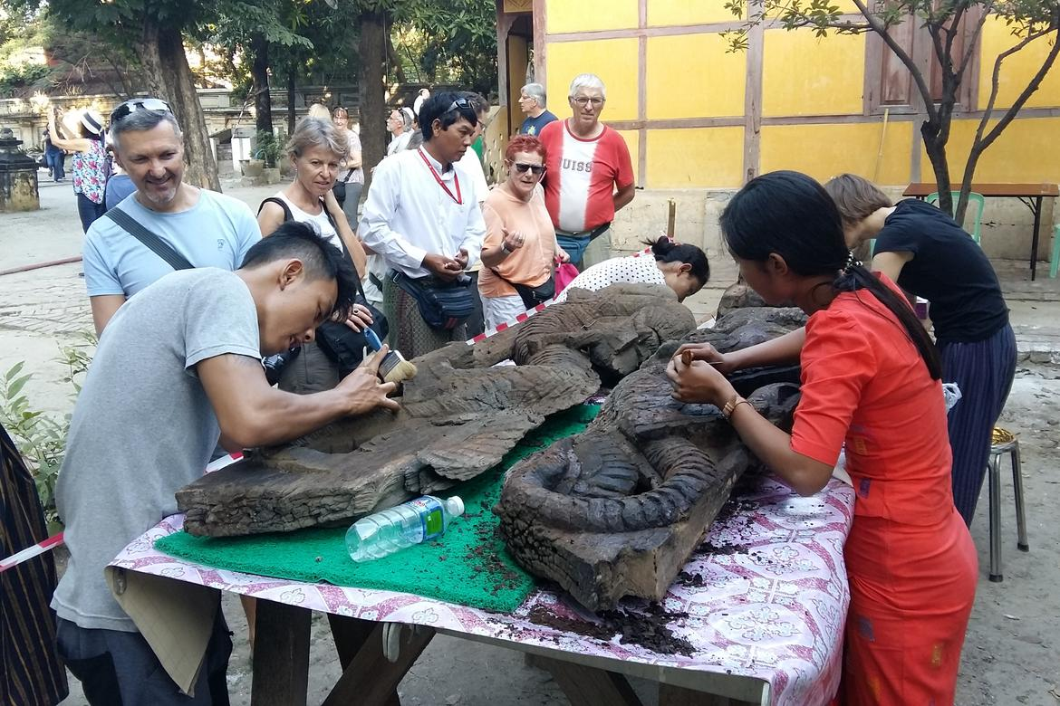 Shwe-nandaw Kyaung visitors watch the nayar conservation work.