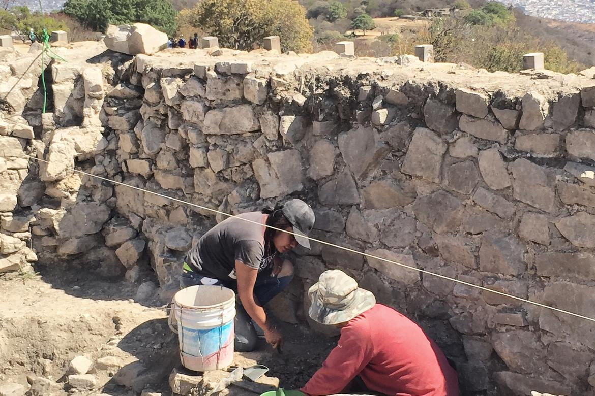 Removing, cleaning, and classifying  little archaeological findings on the top of a pyramid in Monte Albán.