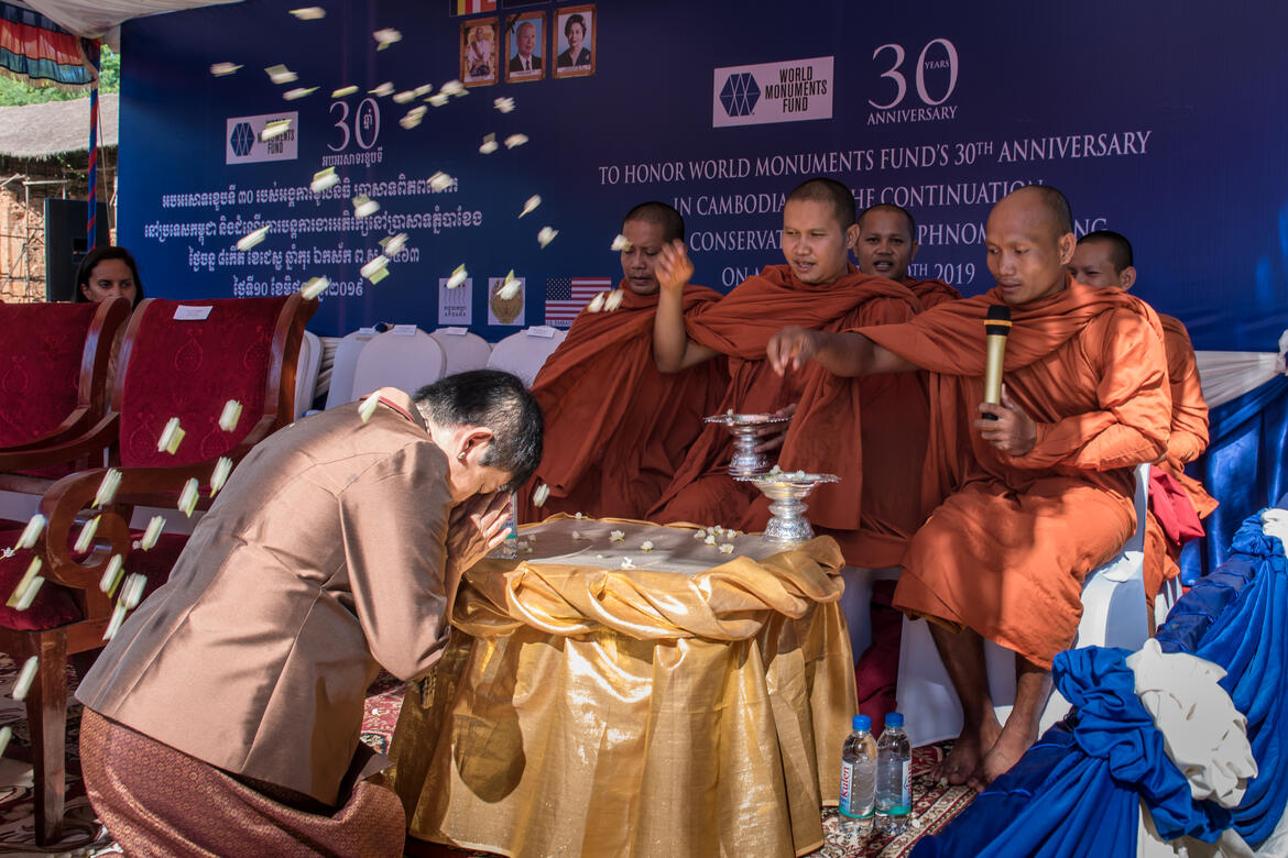 Monks bless Her Excellency Dr. Phoeurng Sackona at celebration event. Photo by Amine Birdouz.