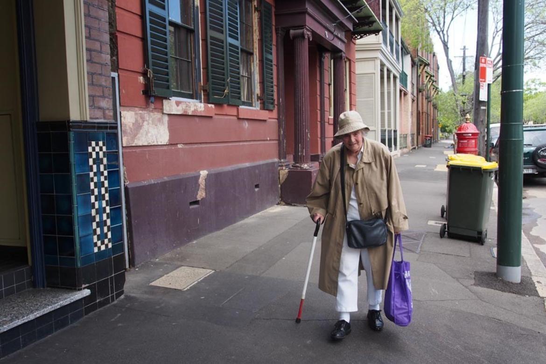Myra walks the neighborhood streets that surround Sirius.