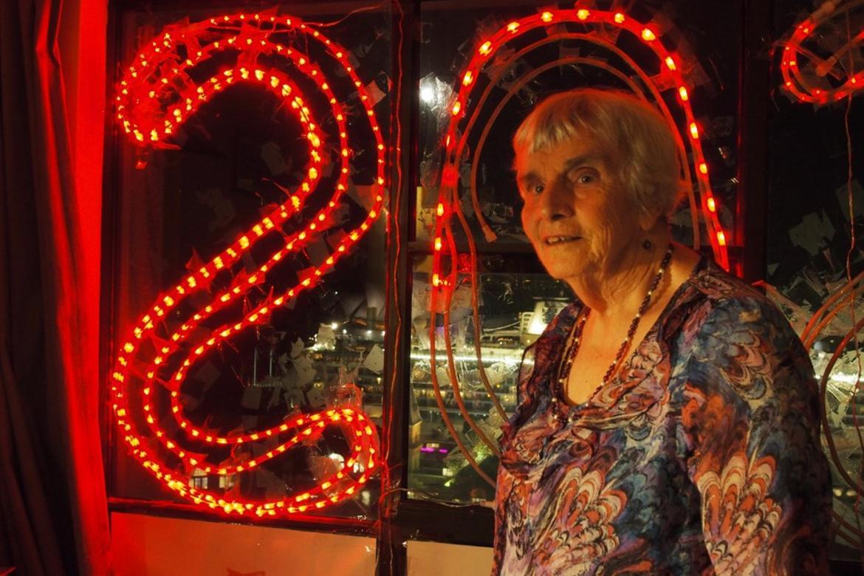 Myra and her S.O.S. sign, illuminated over Sydney Harbor.