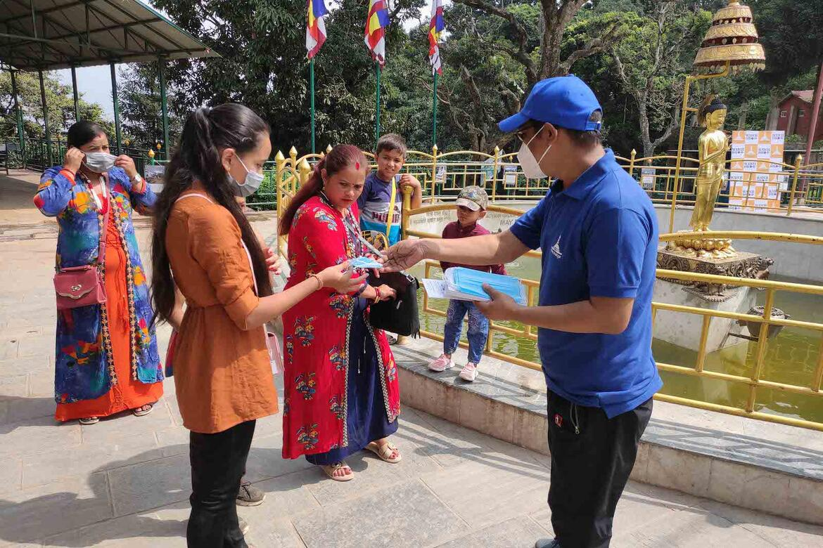 Distributing masks and awareness materials to Watch Day participants.