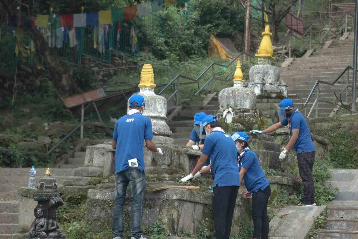 Watch Day volunteers maintaining another set of shrines at Swayambhunath temple, Nepal.