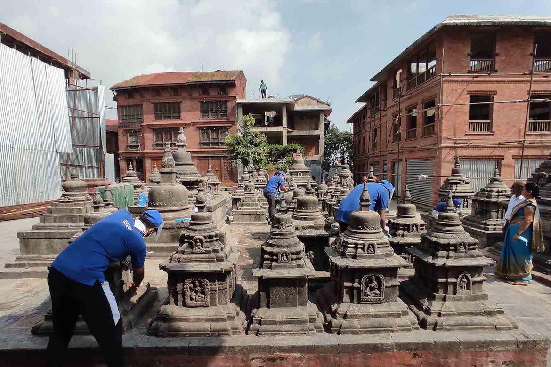 Careful cleaning of the chivas of the Swayambhunath temple, Nepal.