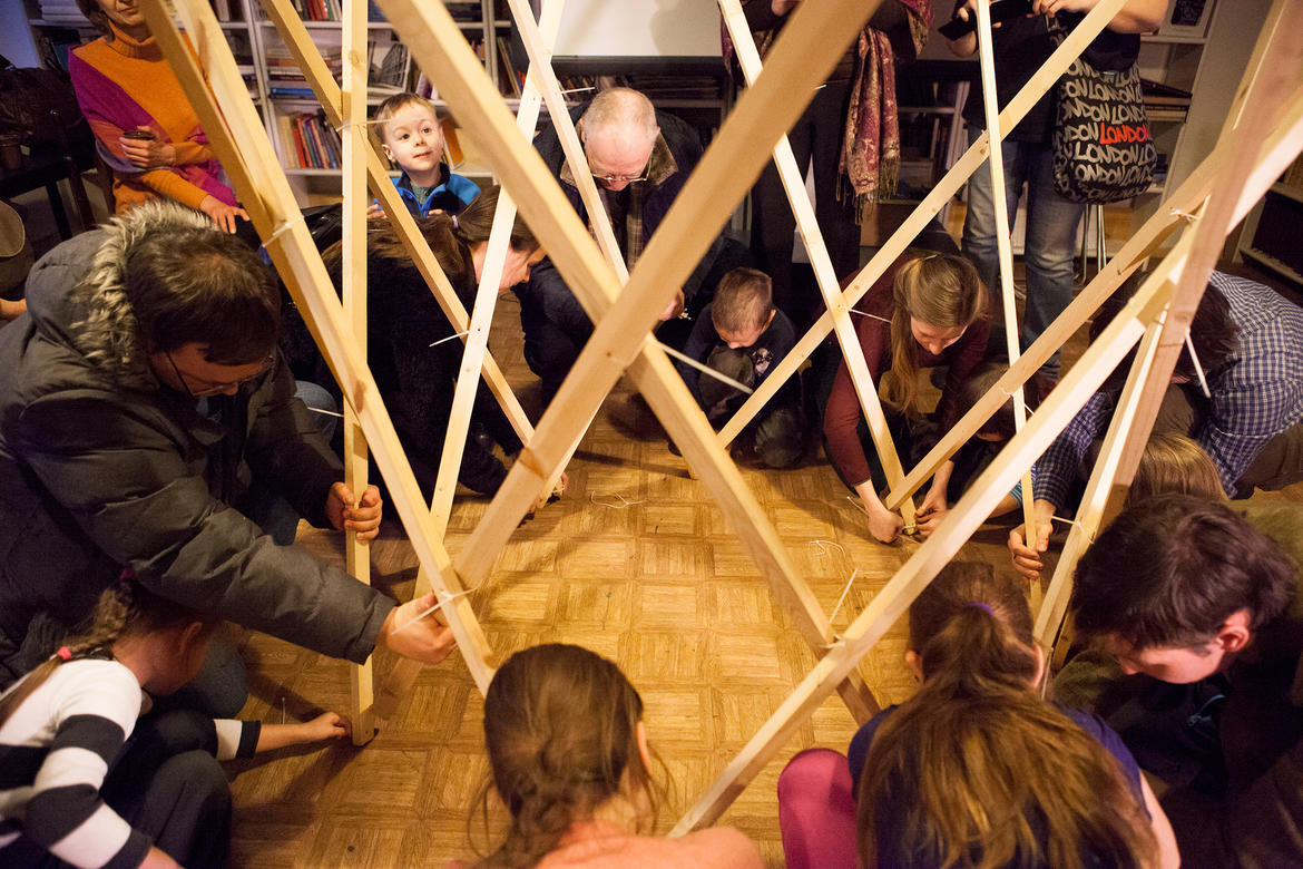 Participants assemble a model section of Shukhov Tower.