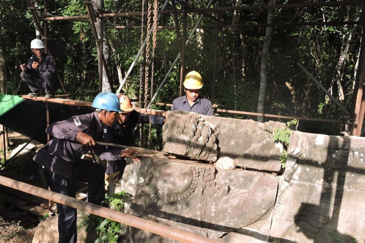 The conservation team dismantling one of the stone units that forms the Garuda
