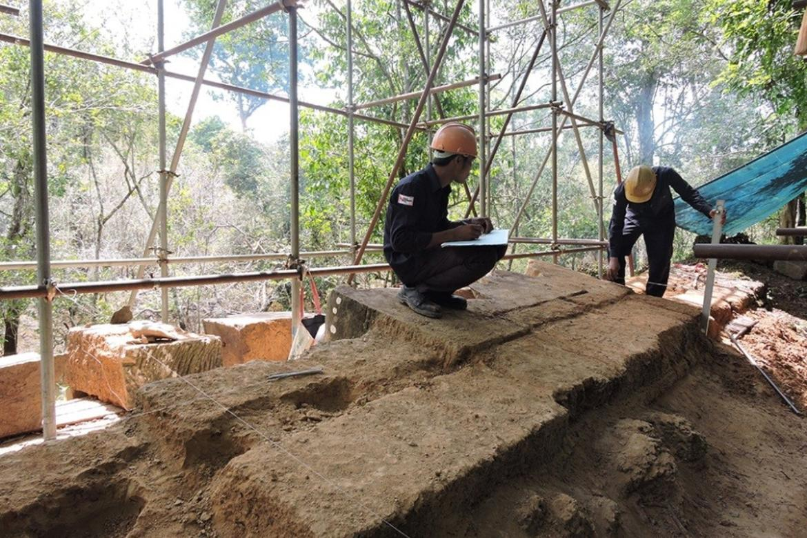 DSCN3678 Workers record and document the structural conditions of the wall in which the Garuda sits