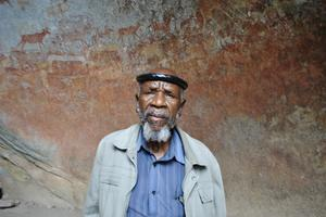David Ngwenya before the endangered rock art of Matobo Hills.