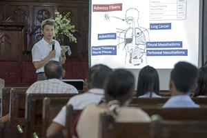 Ken Takahashi informs workshop attendees about the dangers of asbestos