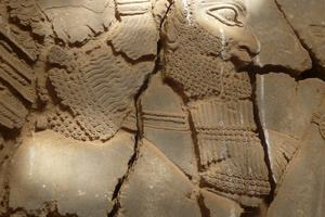 Detail of winged bearded genie, Nimrud, Iraq
