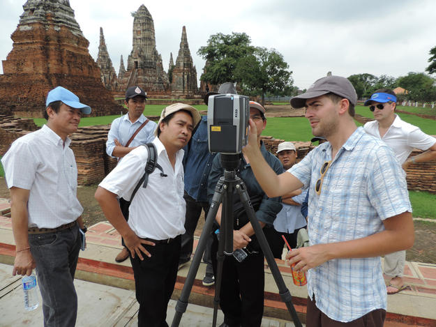 Technicians from University of Florida explaining laser scanning to engineers of the Fine Arts Department of Thailand.