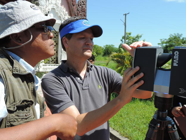 University of Florida's Marty Hylton explains laser scanner operations to Department of Archaeology Engineer Sai Hla Myint Oo, 2014