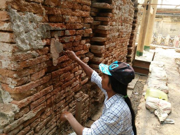 A team member replaces the lime mortar on a monastery staircase, March 2016