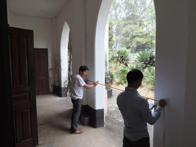 Engineers measure church for site plan, 2016. Photo: Tim Webster.