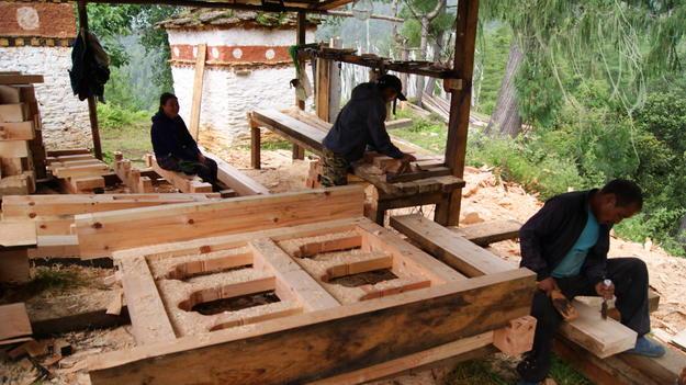 Carpenters making windows, 2016