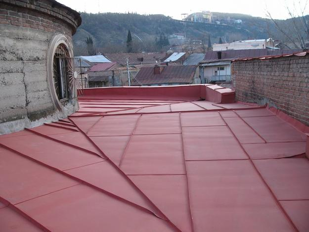 The restored roof cover protects the interior from further water damage, 2005