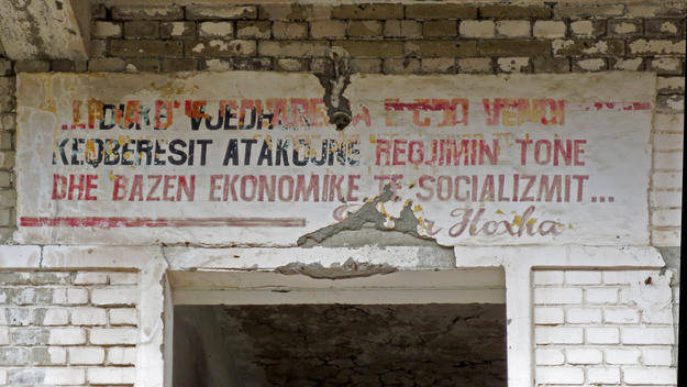 Political slogans painted on the walls were used to exert psychological pressure on the inmates; in this picture a quotation of dictator Enver Hoxha, with black letters used for terms referring to enemies of the regime, 2013